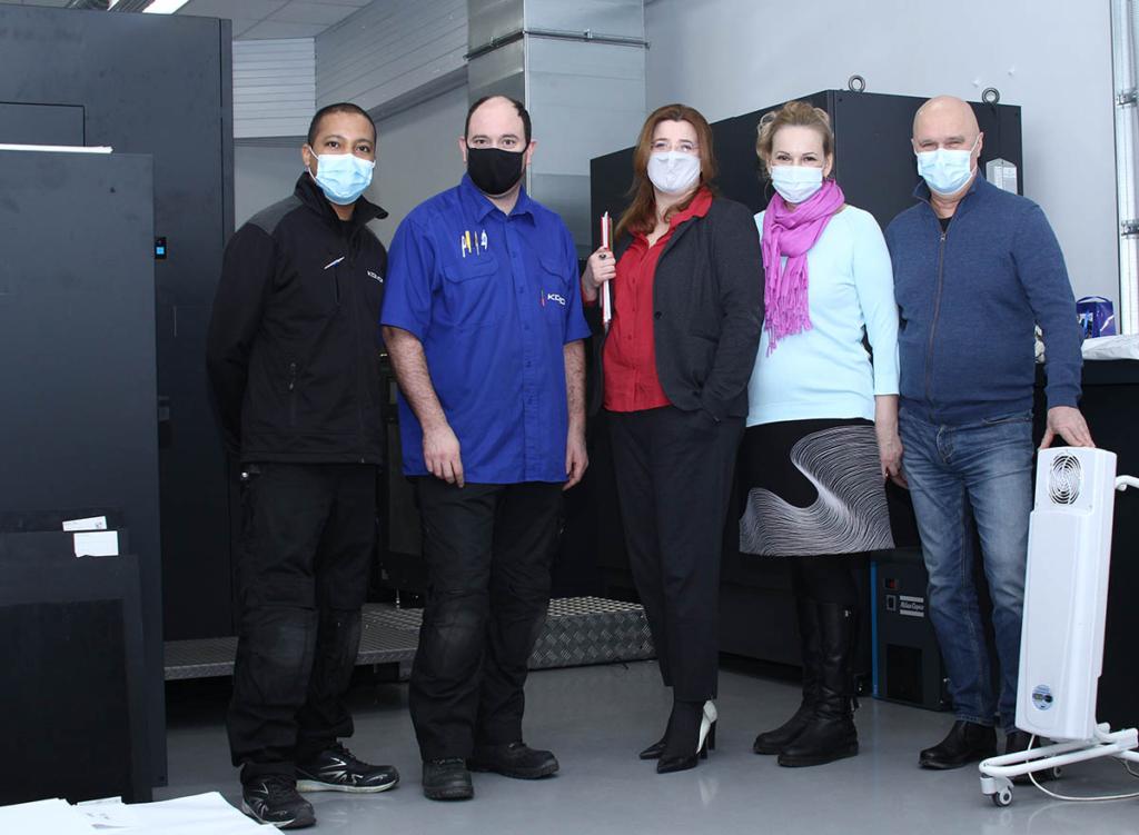 С инженерами Komori